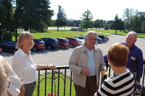 Owners Mario and Joan Arcari speak with Kay Rial Bates, president of the McHenry Area Chamber of Commerce.